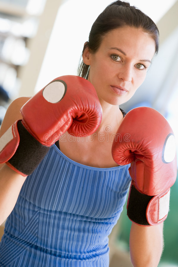 Woman Boxing At Gym stock photo