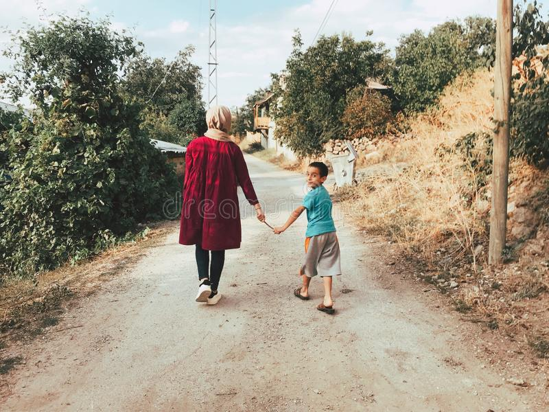 Woman And Boy Holding A Stick While Walking Free Public Domain Cc0 Image