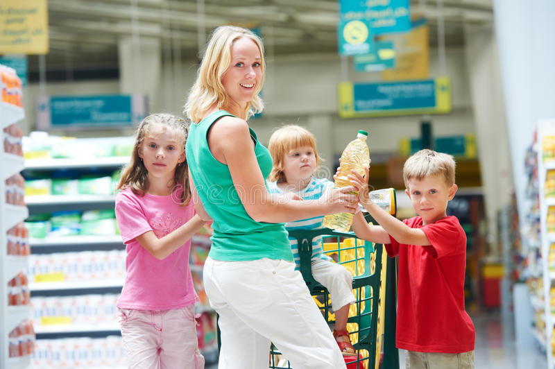 Woman and boy making shopping stock images