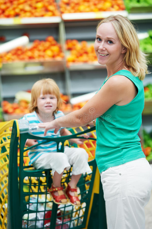 Woman And Boy Making Shopping Royalty Free Stock Images