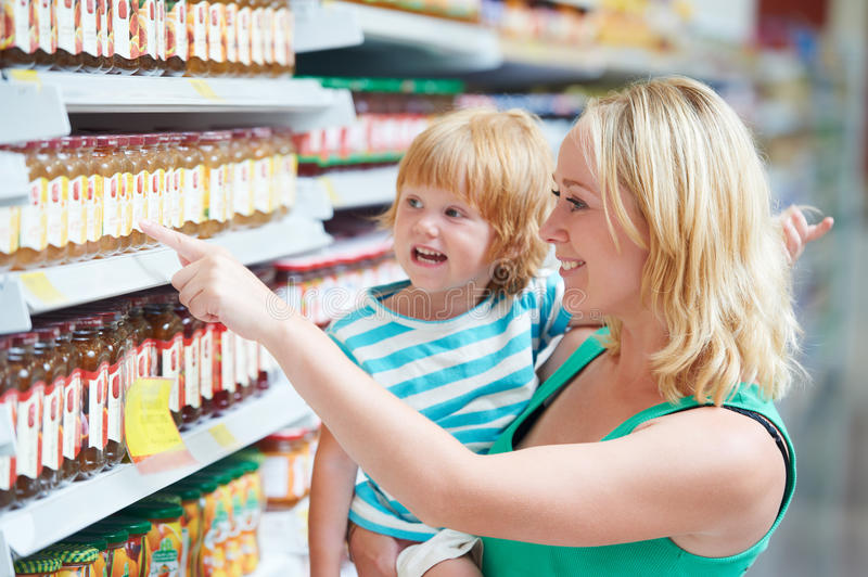 Woman And Boy Making Shopping Stock Photography
