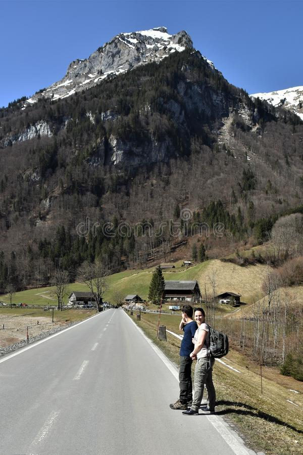 Woman and boy walking on the road around of Klöntalersee lake. In Klöntal, Kloental valley, during sunny spring day - Schwyz Alps, kanton Glarus stock photos