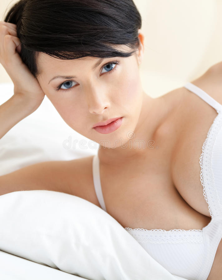 Download Woman In Bra Is Lying In The Bed Royalty Free Stock Photography - Image: 26418877