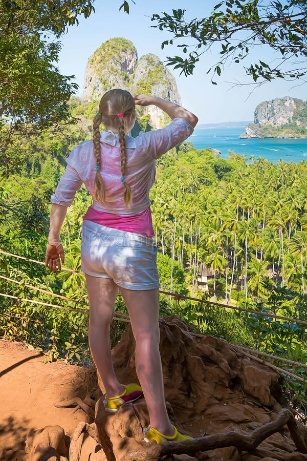 Woman with braids in pink shirt is standing on the top of the hill and watching over the jungles and two sandy tropical beaches. Railay in Krabi province stock image
