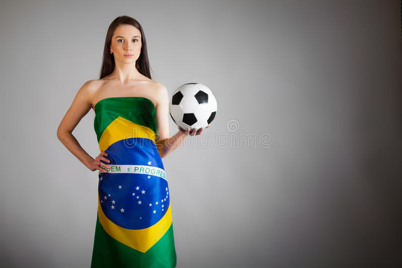 Woman In The Brazilian Flag And Soccer Ball Stock Images