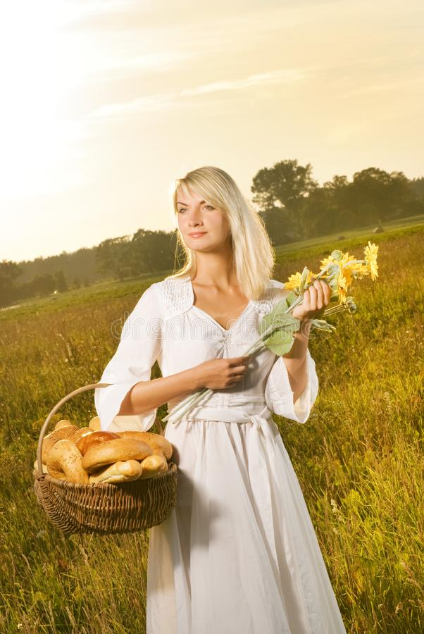 Woman with a bread stock photography