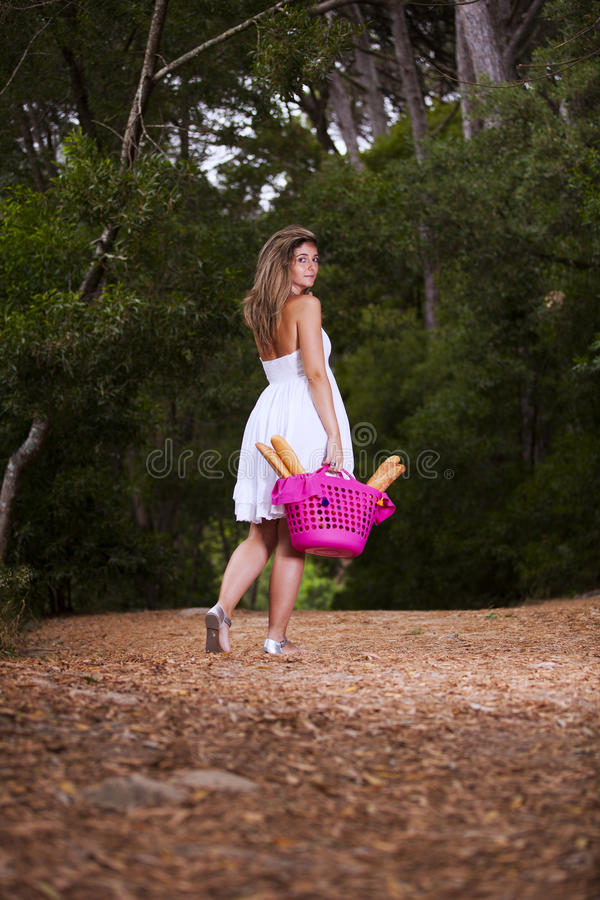 Woman with bread in the basket royalty free stock photos