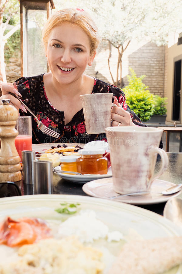 Woman at breakfast stock photography