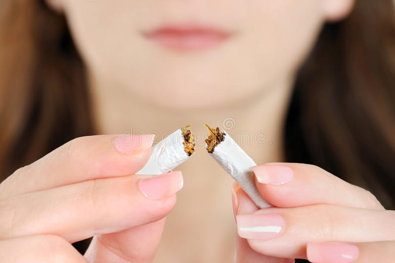 Download Woman Breaking Cigarette Stock Photography - Image: 37471322