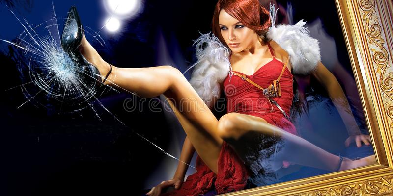 Woman Breaking The Glass. Young beautiful woman breking the glass with a shoe royalty free stock photo