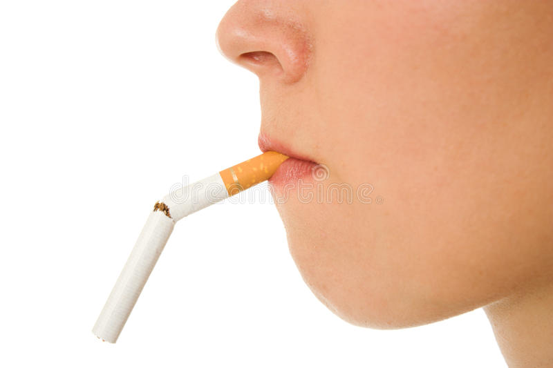 Woman breaks down the cigarette. Woman breaks down the cigarette on a white background stock photos