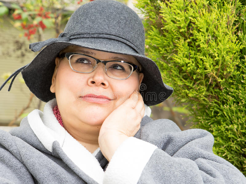 Woman With Breast Cancer Keeps Upbeat Disposition. Hispanic woman dealing with breast cancer treatment keeps an upbeat and happy disposition stock image
