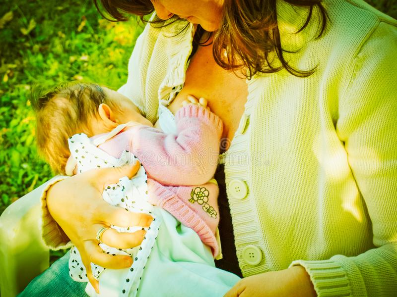 Woman breastfeeding, vintage royalty free stock photos
