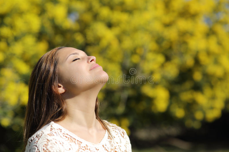 Woman breathing deep in spring or summer royalty free stock photography