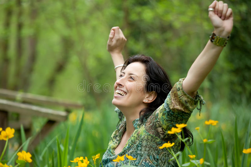 Woman breathing in nature stock photo
