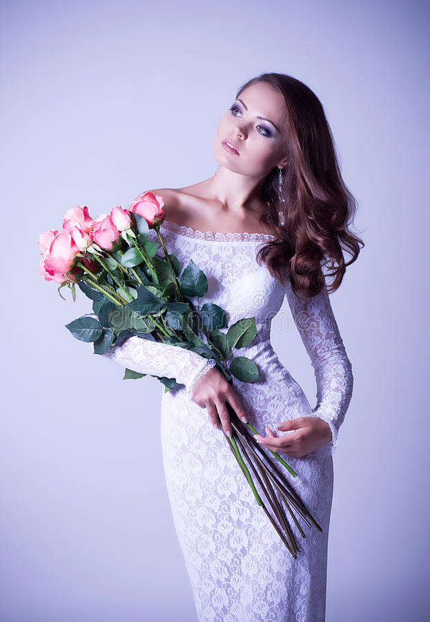Download Woman In Bridal Dress With Bouquet From Roses Stock Photo - Image: 25135840