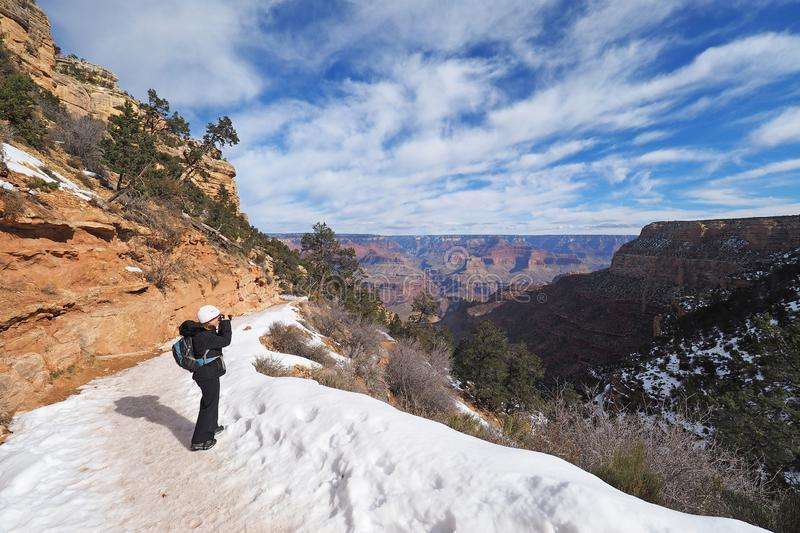 Woman on the Bright Angel Trail in the Grand Canyon in winter. stock image