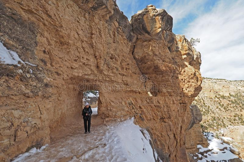 Woman on the Bright Angel Trail in the Grand Canyon in winter. Woman hiking on a snowy Bright Angel Trail in Grand Canyon National Park, Arizona, in winter stock image