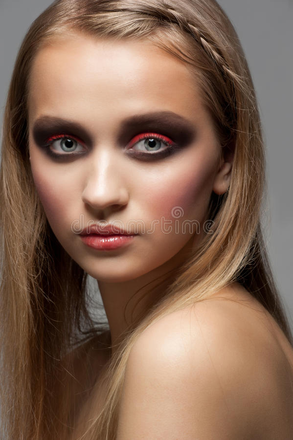 Woman with bright fashion makeup