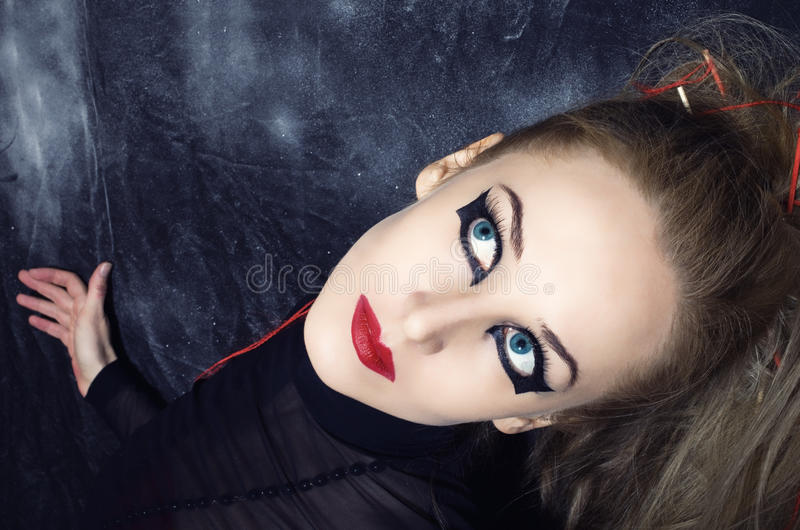 Woman with bright gothic makeup. Portrait of beautiful young woman with bright gothic makeup closeup stock photography