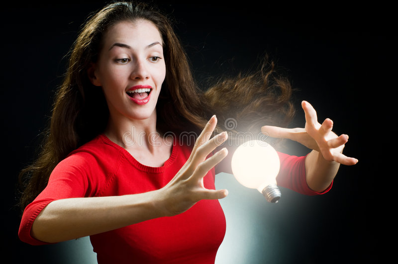 Woman And Bright Light Bulb Stock Images