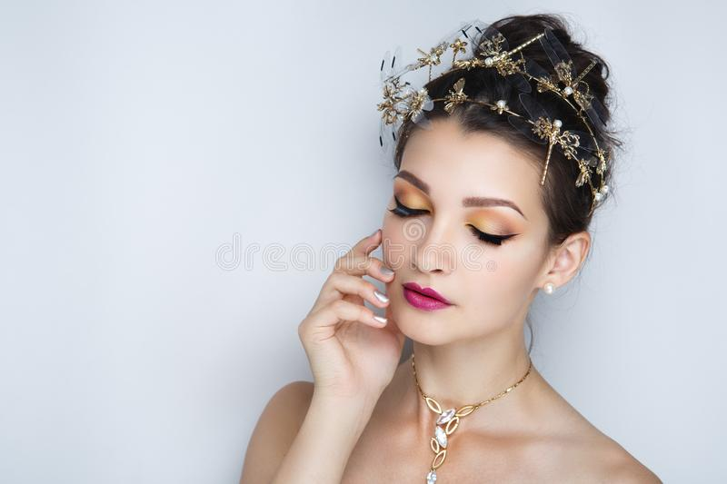 Woman bright make up. Closeup portrait beautiful girl woman lady, volume combed hair-do. Luxury hair styling brunette. Bright shiny shadows makeup, lip-gloss royalty free stock photo