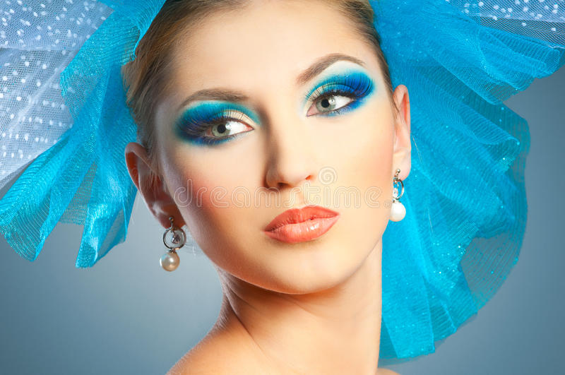 Woman with bright makeup. Glamour beautiful woman in veil hat royalty free stock images