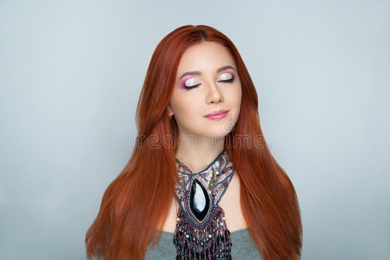 Woman bright orange hair stock images