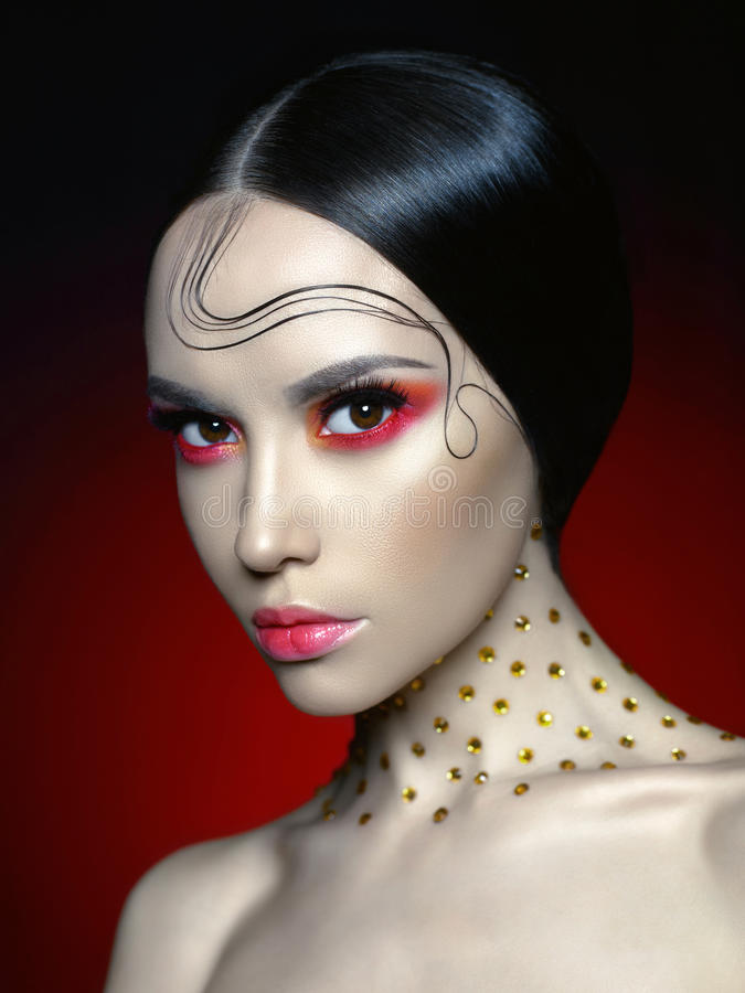 Woman with bright red makeup. Fashion studio portrait of beautiful woman with bright red makeup. Fashion and Beauty. Perfect makeup royalty free stock photo