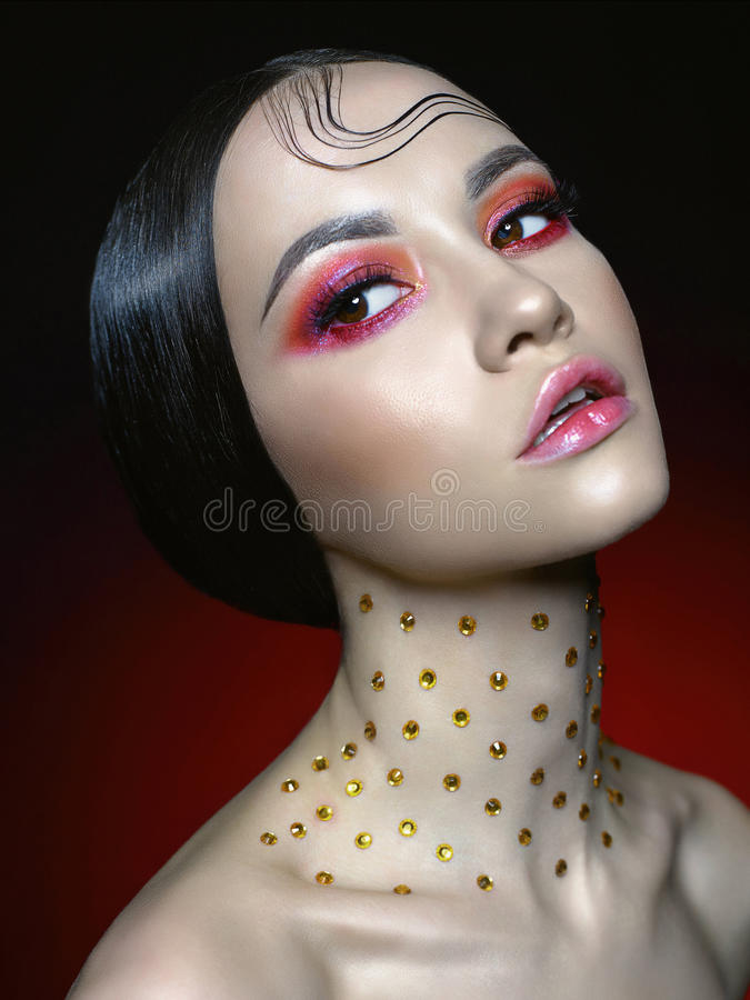 Woman with bright red makeup. Fashion studio portrait of beautiful woman with bright red makeup. Fashion and Beauty. Perfect makeup royalty free stock photos