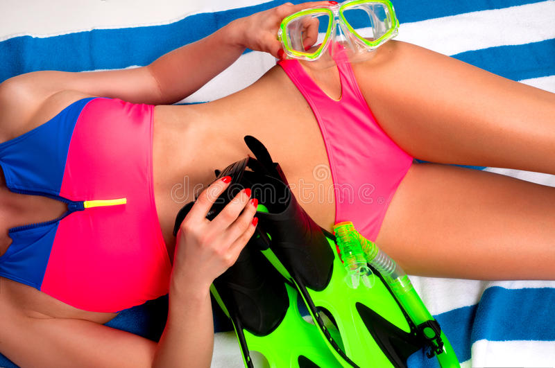 Woman in bright swimsuit with mask, snorkel and flippers. royalty free stock photography