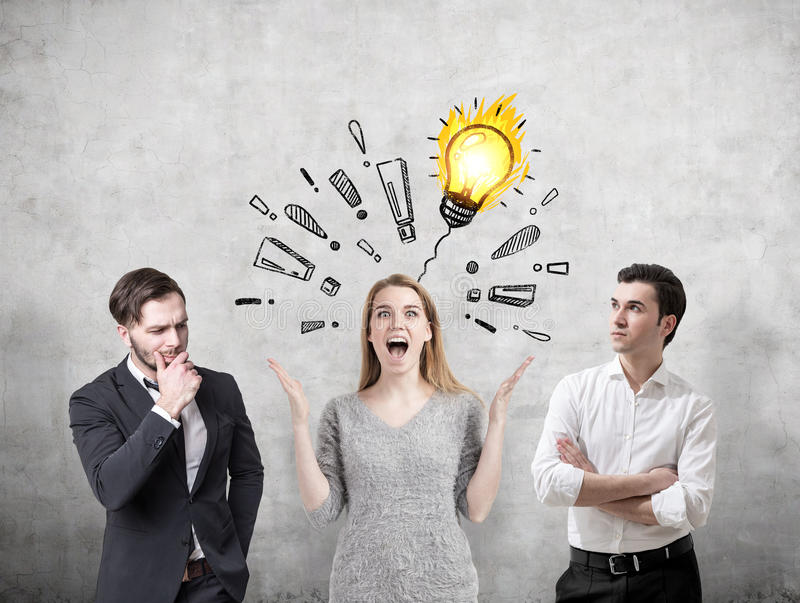 Woman with a brilliant idea and her colleagues stock image
