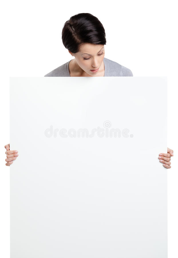 Download Woman Brings A Huge Sheet Of White Cardboard Stock Photo - Image: 26029274