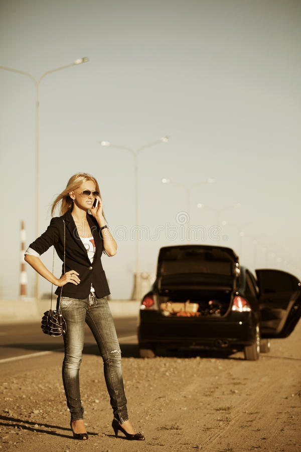 Woman With Broken Car Calling On The Phone Stock Photo