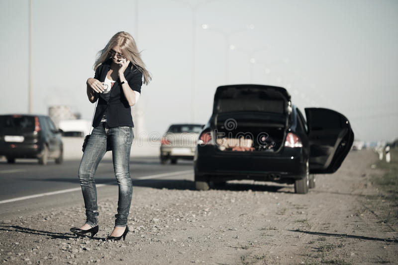 Fashion woman at the broken car outdoor