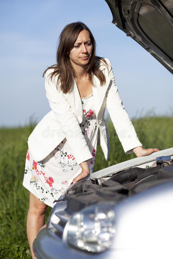 Download Woman and broken car stock photo. Image of people, person - 25397156