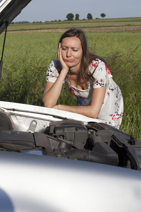 Download Woman And Broken Car Royalty Free Stock Photography - Image: 25399087