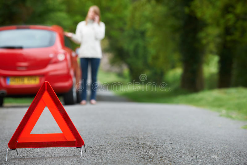 Woman Broken Down On Country Road Calling For Help royalty free stock images