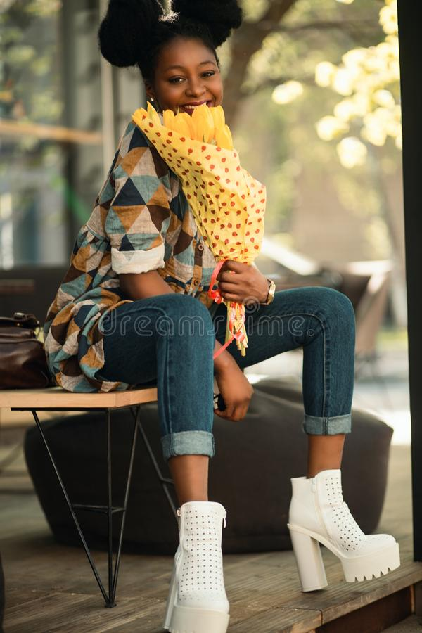 Woman in Brown and Blue Quarter-sleeved Dress Sitting on Chair royalty free stock photo