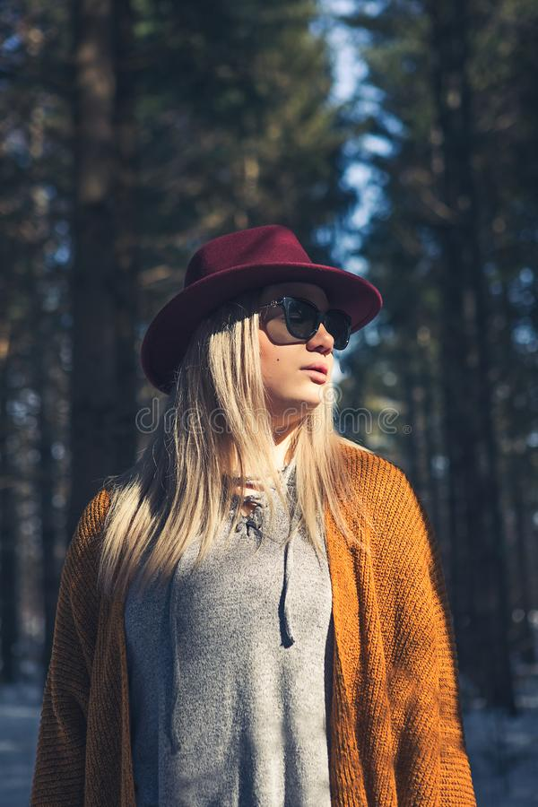 Woman in Brown Cardigan and Gray Top Near Green Leaf Trees at Daytime royalty free stock photography