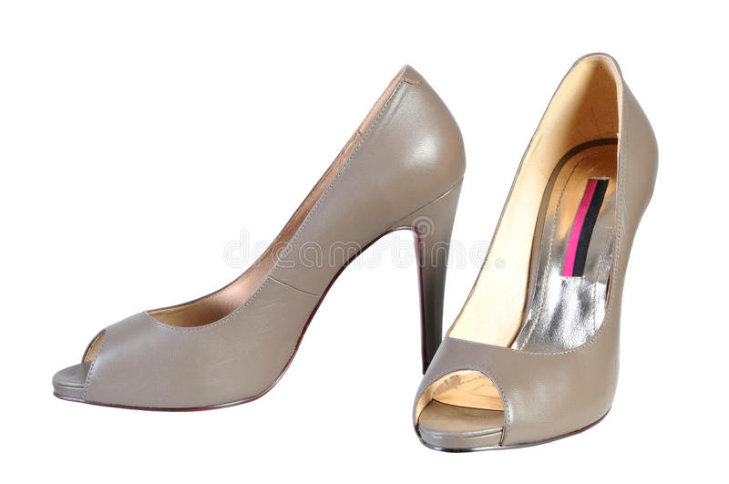 Woman brown fashion shoe high heels on white background royalty free stock images