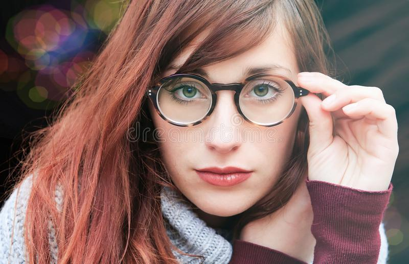 Woman With Brown Hair Wearing Eyeglasses royalty free stock photos