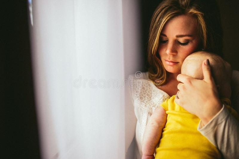 Woman In Brown Long Sleeve Shirt Carrying Baby In Yellow Shirt Free Public Domain Cc0 Image