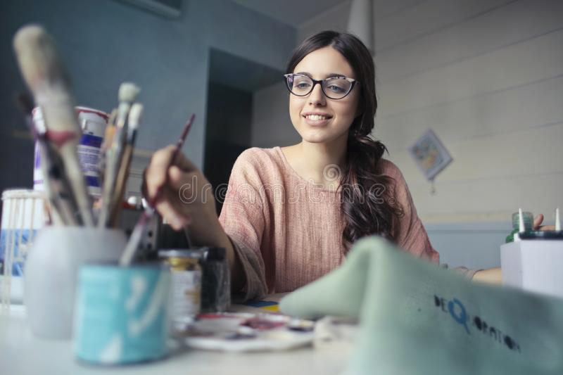 Woman In Brown Long-sleeved Shirt Wearing Eyeglasses Holding Paint Brush Free Public Domain Cc0 Image