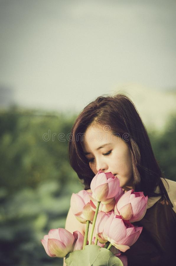 Woman In Brown And White Sniffing Pink Flowering Plant Free Public Domain Cc0 Image