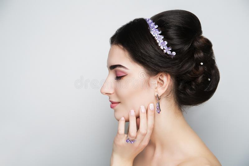 Woman brunette hair styling stock photo