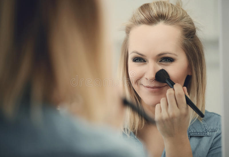 Woman with a brush stock photography