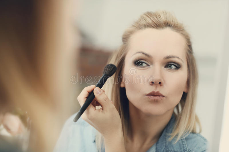 Woman with a brush royalty free stock image