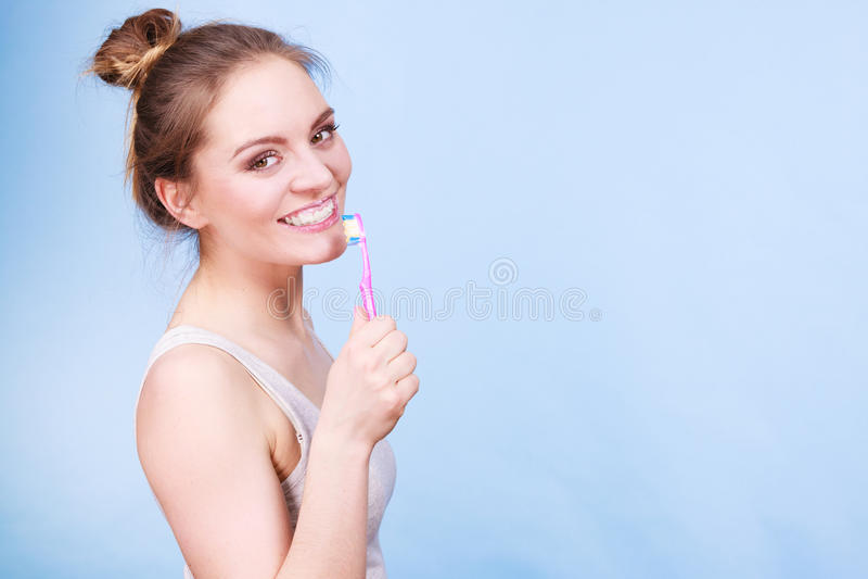 Woman brushing cleaning teeth royalty free stock image