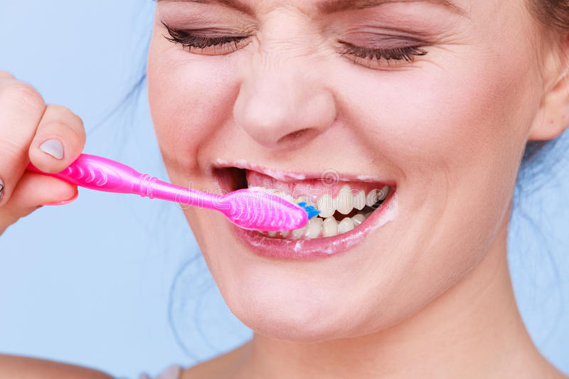 Woman brushing cleaning teeth royalty free stock photo